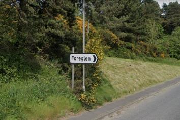 Dungiven Irish language street sign plan blocked