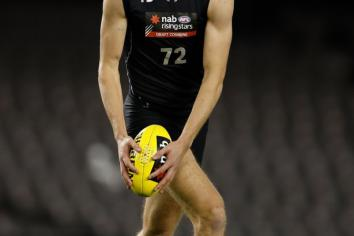 Anton Tohill waves goodbye to Aussie Rules